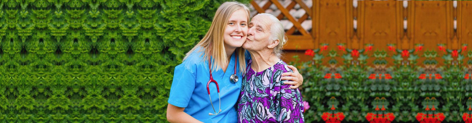 senior woman kisses a medical personnel
