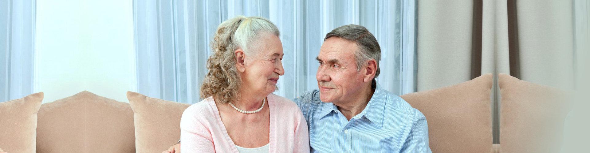 two elderly person talking